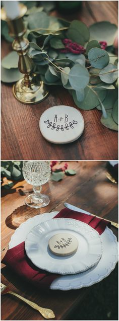 Outdoor wedding reception place setting, ruby red napkins, loose leaves, gold flatware, circular wood monograms // Kelly Boitano Photography