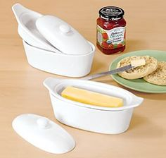 "Keep butter fresh, soft, and spreadable for weeks—without refrigeration! Simply place butter in the top dish, fill the base with cold water and place butter dish over the water-filled base. 3-piece set includes a lid. Holds one standard size stick of butter. Stone­ware with glazed finish; dishwasher and micro­wave safe. 8¼"" L x 3½"" W x 3½"" H.  $12.98"