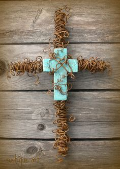 "10"" rusty wire wall cross with large turquoise focal"