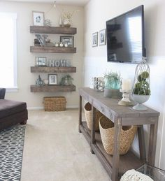 Love these wall shelves! They remind me of wooden beams that you see in living/dinning rooms. The wooden table under the TV is amazing, too. Love that rustic vibe