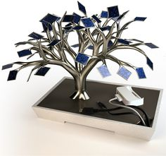 The Bonsai Charging Tree    The leaves are 54 solar panels that when charge can recharge your phone. Interesting.