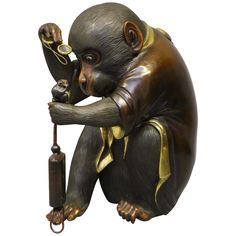 Antique Japanese Bronze of a Monkey with a Pair of Glasses | From a unique collection of antique and modern metalwork at https://www.1stdibs.com/furniture/asian-art-furniture/metalwork/
