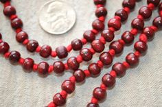 A personal favorite from my Etsy shop https://www.etsy.com/listing/213677802/108-rosewood-red-sandalwood-hand-knotted # 108 hand knotted rosewood mala beads necklace # red wooden long tassel mala beads