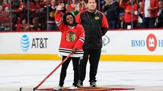 Simone Biles shoots puck at Chicago Blackhawks game (Video)