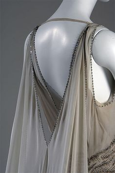 Vionnet design for Mrs. Potter Palmer II    Gown, 1938    Madeleine Vionnet    Smoke-gray chiffon, rhinestones and silver beads. Worn by Mrs. Potter Palmer II when she was presented to the Queen of England in 1938.    This gown is one of more than 60 couture pieces featured in the exhibition Chic Chicago: Couture Treasures from the Chicago History Museum.    © Chicago History Museum  www.chicagohistory.org/