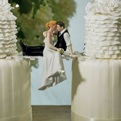 This wedding cake top is pure romance! Forget the traditional standing figurine cake topper. This bride and groom is caught taking a moment for romance and sneaking a kiss. You can place the Groom ato