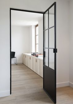 Black on White, doors, doorway, entrance, steel doors, white walls