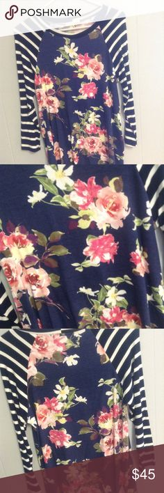 NWT Size Small Boutique Floral Shirt New with tags. Boutique floral shirt size small. From a smoke free home. Tops