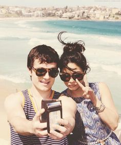 Josh Hutcherson on the beach with his girlfriend.