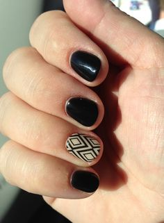 Black & Tan Art Deco shellac nail strips (at Walmart or drug stores) and took them to my nail place to put on with a black shellac gel manicure.  LOVE!!!!!!