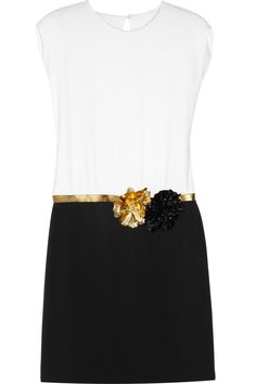 Iconic Italian brand Gucci is all about high-octane glamour, and this two-tone silk dress epitomizes the look perfectly. The sleek, minimalist cut is chicly offset by a bronze leather waistband and floral appliqués. Wear it to your next cocktail party with your favorite black heels and a box clutch.