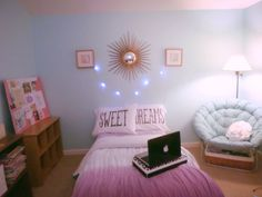 My room: after redecorating. (This is my actual room). Teen room, teal walls, starburst mirror, string lights, pbteen bedding, tumblr