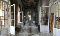 Forgotten: Peeling walls and doors in the Ospedale Psichiatrico di Volterra, in Tuscany, Italy, where 6,000 patients lived