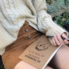 Tan suede button down skirt and white knit sweater. A cute and casual fall or winter outfit.