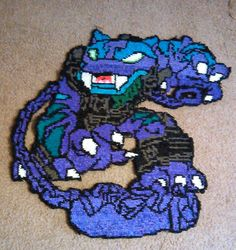 "Rainbow Loom Mural of Trap Shadow from the Skylanders. Size 27"" by 27"", over 23,000 bands used. Created by Angel Green. Posted on Facebook. https://www.facebook.com/photo.php?fbid=1625251307698746&set=o.340822649338519&type=1&theater"