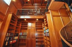 Two Story Library with Mahogany Hardwood and a spiral staircase