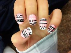 Baby pink/black/white rounded square tip nails with a different pattern on every nail.