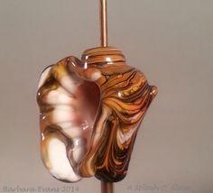 Wood grain effect on glass seashell.