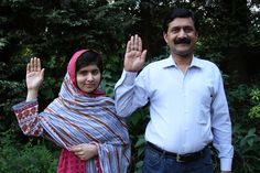 Malala Yousafzai and her father Ziauddin raise their hands to support girls' education. Credit: A World At School