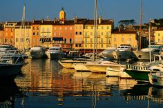 St. Tropez - harbour boats and waterfront houses.