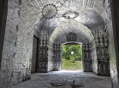 The Shrine by NeSpoon, uses enlarged patterns of old lace and stencils them onto urban landscapes. Cool!