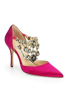 """Manolo Blahnik Zullin Satin Jeweled d'Orsay Pumps $1285.00       Self-covered heel, about 4"""" (105mm)     Satin upper with crystal adornments     Point toe     Elasticized side straps     Leather lining and sole     Padded insole     Made in Italy"""