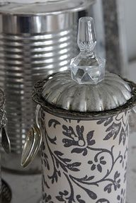 Kitchen canisters created from coffee or soup cans covered with vintage fabric.