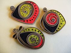 Abstract zipper and felt brooches by woolly fabulous, via Flickr