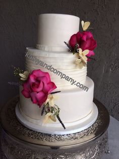 Kathy & Co. Smooth buttercream wedding cake with ruffle tier and fresh flowers.