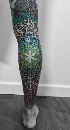Another geometric tattoo design (now with vibrant colors for more appealing look) that you can have for you calves that extends to your thighs.