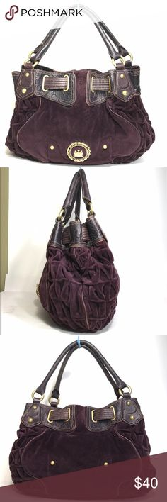 """Juicy couture Deep purple large velvet tote Mulberry velvet and brown leather large """"old school"""" satchel/tote. Differing textures of velvet and accents in both smooth and embossed leather with goldtone hardware. Crazy cool color pairing with a magenta lining. Leather piping is showing wear, but this is an old juicy couture bag-to me it adds character. And it let's everyone know your sense of style goes deeper and farther back than last month's must have bag. Juicy Couture Bags Satchels"""
