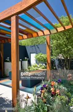 Stock Photo : Stained glass shelter over patio area, 'University of Worcester Garden', RHS Chelsea Flower Show 2010, designed by Olivia Kirk