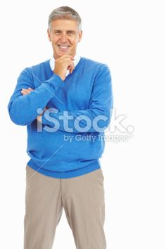 Mature man smiling with fingers on his chin Royalty Free Stock Photo