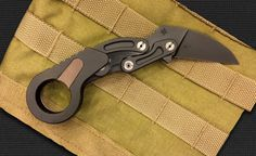 Caswell Knives Morphing Karambit grabbed the attention of the knife world this week.