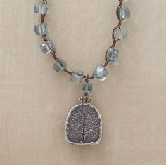 """Faceted nuggets of translucent green mystic quartz suspend a handcrafted sterling silver pendant, complemented by silver-plated links and a sterling toggle clasp with silver lilypad charms and a mystic quartz drop. Handmade in the USA by Adriana Goddard. Approx. 36""""L."""