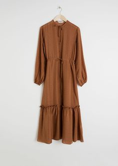 993d9a34a9a8 Long sleeve polka dot midi dress with a neck tie detail