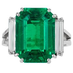 An Emerald & Diamond Ring | From a unique collection of vintage three-stone rings at https://www.1stdibs.com/jewelry/rings/three-stone-rings/