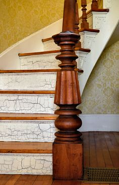 Crackle finish on curved staircase with original wood railings in foyer of 1860s farmhouse.