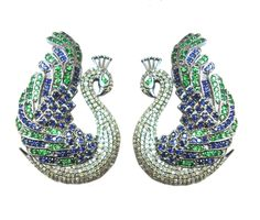 Design Code:LBE-2275  An traditional touch given in the form of the national bird, beautifully designed peacock earring with diamond, blue sapphire and tsavorite in sterling silver.