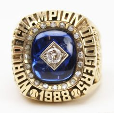"1988 Los Angeles Dodgers World Series ring. Sadly, I'm posting this image on my ""Vintage Baseball Stuff"" page because it's been so long since the Dodgers have won the World Series, and the 1988 World Series sees like a vintage event. Dodgers Gear, Dodgers Nation, Let's Go Dodgers, Dodgers Baseball, 1988 World Series, World Series Rings, Dodgers History, Kirk Gibson, Sandy Koufax"
