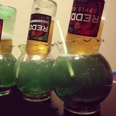 THE FISH BOWL 2 oz. (60ml) Bacardi Rum 2 oz. (60ml) Green Apple Vodka 1/2 oz. (15ml) Peach Schnapps Top with 7up and Hawaiian Punch Redds Apple Ale Nerds Gummy Bears #FishBowl #cocktail #vodka...