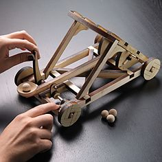 Since we really don't need catapults to attack and defend castles these days, they are exclusively used for fun. And this Wooden Catapult Kit is all about fun. Wood Projects For Kids, Woodworking Projects For Kids, Woodworking Toys, Catapult Diy, Wood Toys, Wooden Diy, Diy Toys, Wood Art, Wood Crafts