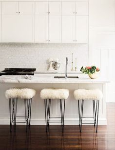 White kitchen with furry stools