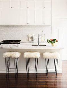 White kitchen with furry stools