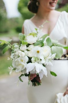 All white bouquet with a touch of greenery: http://www.stylemepretty.com/little-black-book-blog/2014/08/15/rustic-audubon-wedding-inspiration/ | Photography: Erin McGinn - http://www.erinmcginn.com/