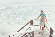 Posing oceanside, Viktoriya Sasonkina models cropped sweater, embellished dress and shoes from Tommy Hilfiger