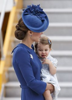 Kate Middleton Photos Photos - Catherine, Duchess of Cambridge and Princess Charlotte of Cambridge arrive at 443 Maritime Helicopter Squadron near Victoria international airport on September 24, 2016 in Victoria, Canada. Prince William, Duke of Cambridge, Catherine, Duchess of Cambridge, Prince George and Princess Charlotte are visiting Canada as part of an eight day visit to the country taking in areas such as Bella Bella, Whitehorse and Kelowna. - 2016 Royal Tour to Canada of the Duke and…