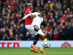 Nathan Dyer of Swansea City is challenged by Ashley Young of Manchester United during the Premier League match between Manchester United and Swansea...