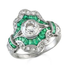 Beautiful Art Deco Emerald and Diamond ring. The center diamond is an approximately 0.85 carat Old European cut. Set in platinum.