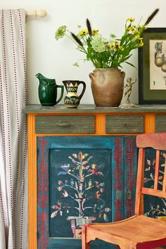 Cabinet found on Annie Sloan's Facebook page: In my boho bedroom in France - a sideboard painted in Aubusson and Barcelona with a paper cut out on the front panels and side panels too.